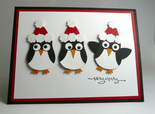 handmade penguin christmas card using owl punch and wearing santa hats
